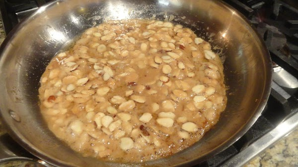 To make sugared almonds,melt butter in skillet, add sugar, then almonds. Stir until sugar...