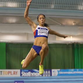 by Ron Russell - Sports & Fitness Running ( flight, female heptathlete, distance, winning, practise, height, strength, effort )