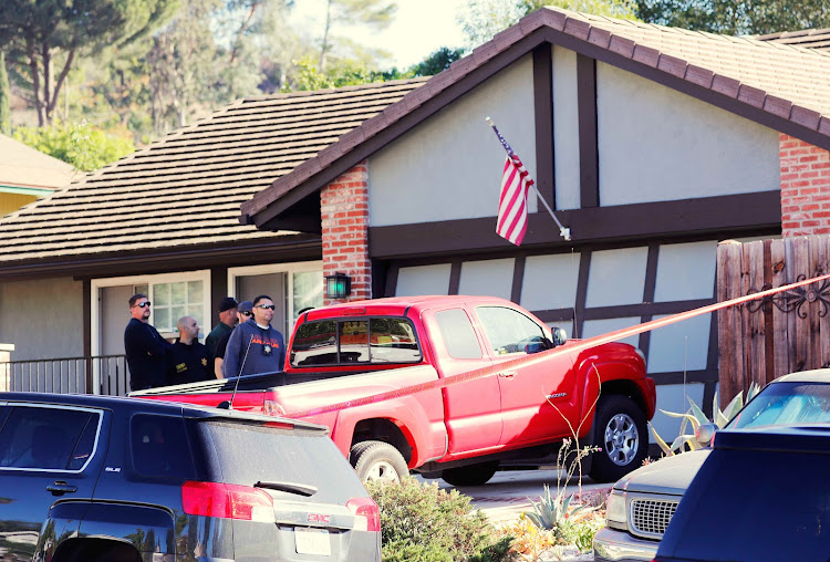 Police and FBI officers wait outside the home of the suspect in a shooting incident at a Thousand Oaks bar, in Newbury Park, California, U.S. November 8, 2018.