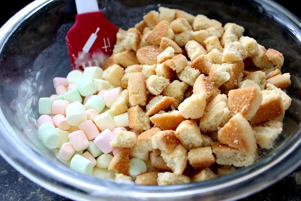 Add marshmallows; stir to coat. Gently stir in cookie pieces until combined.