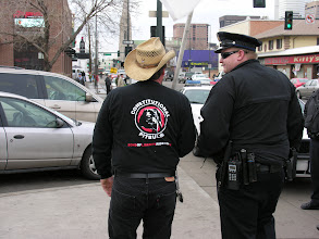 Photo: Police officer with Sons of Liberty Riders; photo by Bob Glass; posted with permission by Ari Armstrong.