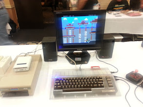Photo: C64 with transparent case from Kickstarter campaign, running Bruce Lee 2 from EasyFlash, connected to VGA monitor