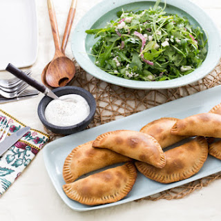Baked Empanadas de Picadillo with Arugula, Queso Fresco & Pickled Onion Salad