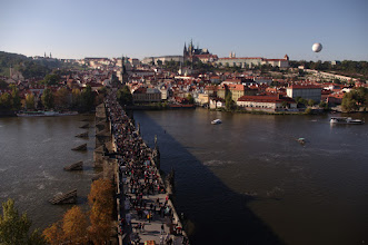 Photo: Tourist wave running over the Charles Bridge. Prague castle and cathedral in the background.