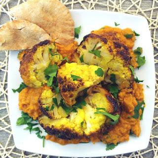 Roasted Cauliflower Head with Creamy Red Lentil Dahl [vegan]