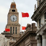 famous Shanghai skyline of the bund with the national flag of China in Shanghai, Shanghai, China