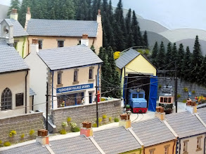 Photo: 134 The little tram shed hosts a steeple cab electric loco, with the village stores sited on the terrace just above it .