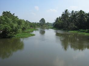 Photo: Sông chảy qua cầu Bình Nhâm