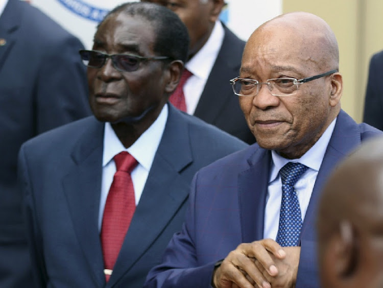 President Jacob Zuma (right) and Zimbabwean President Robert Mugabe. Picture: REUTERS/PHILIMON BULAWAYO