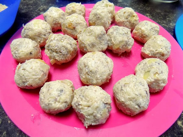 Add enough breadcrumbs to hold together. Roll into small balls.