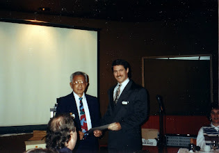 Photo: Chapter President Ross McIntyre (right) presents a Life Membership Certificate to George Tamura