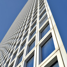 The edge by Natalie Ax - Abstract Patterns ( sky, blue sky, business, city, isolated, squares, office, abstract, windows, building, edge, urban, blue, white, corner, architectural detail, background, unique, perspective, detail, office building, architectural, unusual, architecture )