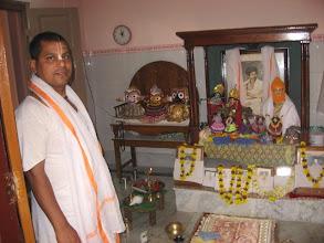 Photo: Sri Brajabandhu Brahmachari and the shrine and altar with Prabhu Jagadbandhu, Jagannath, Balaram and Subhadra
