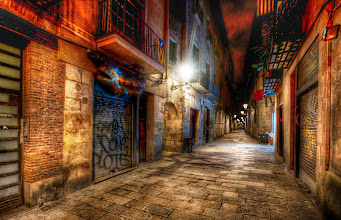 Photo: The Endless Alley in Barcelona -   The dirt and grit and color that comes with European alleys make for great subjects for dynamic night photography.  Usually I only stay out for about an hour after it gets dark, but it's hard to stop with this kind of scenery...  I mean, you can make a legitimate excuse to stay out all night!  But a lot of people warned me about how dangerous Barcelona can be...  I did already meet many people that were robbed blind...  I was extra-extra careful... and, in this case, decided to head back to the hotel early.  Also, I was feeling pretty under the weather...so yet another excuse. - from Trey Ratcliff at http://www.StuckInCustoms.com - all images Creative Commons Noncommercial