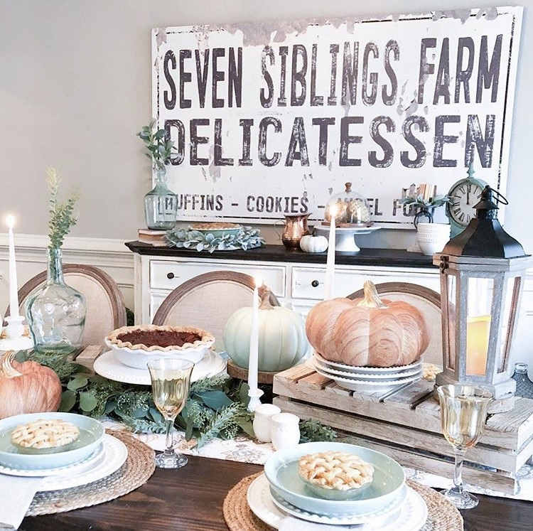 thanksgiving tablescape with pies, candles, pumpkins and pastel colored accents