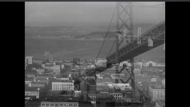 """Photo: Shot 4 of 18.  Duration: 2 seconds.  The fourth and nearly-last establishing shot.  Dissolves connect them all, indicating weak temporal relations. Together the montage spells out a place but not a duration.  Alcatraz is apparently a distant third in signifying """"San Francisco""""--behind the two bridges.  This will dissolve to the interior of Sam Spade's office."""