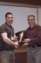 Photo: Bradley Wheeler accepting the Ross N. Tucker Memorial Award.