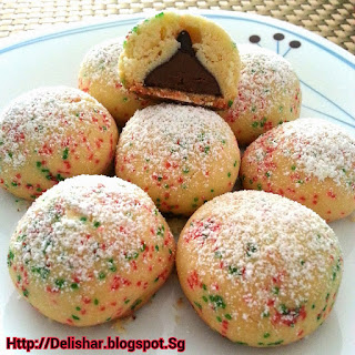 Kisses Stuffed Snowball Cookies