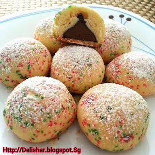 Kisses Stuffed Snowball Cookies.
