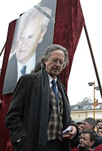 Photo: Peter Handke is seen before his speach at the rally just before the funeral of late Serbian leader Slobodan Milosevic,in his native town of Pozarevac, Saturday, March 18 2006.  (AP Photo/Petar Pavlovic)