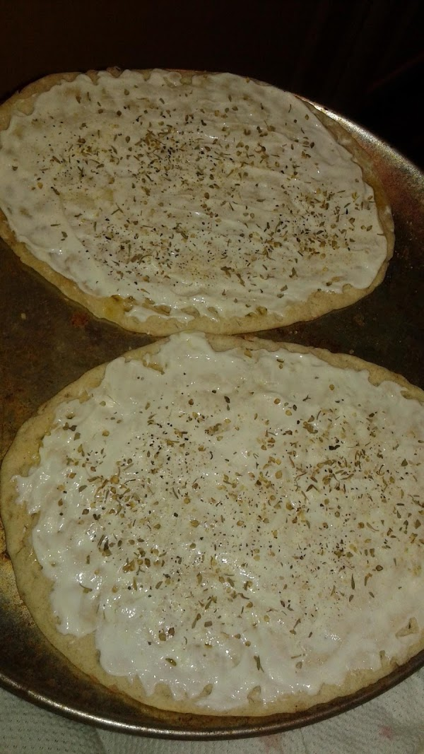 Next, sprinkle the salt, pepper, oregano, garlic and onion powder over top.