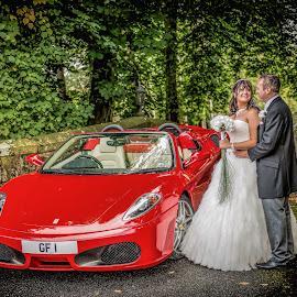 Big Red Ferrari by Peter Anslow - Wedding Bride & Groom ( wedding photography, wedding photographers, ferrari, wedding dress, car show, wedding photography prices, wedding photographer )