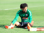 Keagan Dolly, who plays for Montpellier in the French Lique1, stretches during the Bafanaa Bafana training session at Princess Magogo Stadium in Durban September 3 2018.