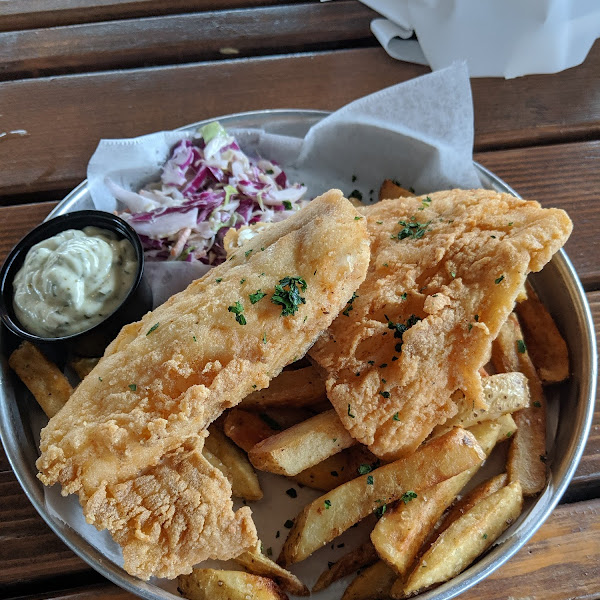 Dedicated fryer. I got the fish and chips. So delicious and no reaction. I highly recommend giving it a try. Just make sure you tell your server of allergies.