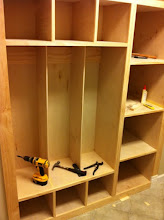 Photo: Once the cabinets were all in and secured, I began to face them with trim.