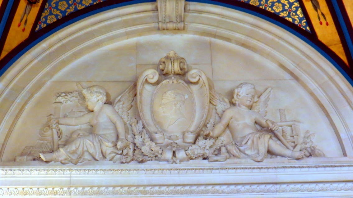 A pair of Cherubs carved in marble. On the left is a Cherub with a train, the source of the Vanderbilts' wealth.