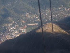 Photo: Looking almost straight down at Chamonix, the midway station is visible on the knoll below.