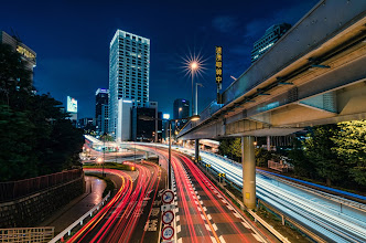 Photo: Cars zoom by on a July evening in the heart of Tokyo  Blog: http://lestaylorphoto.com