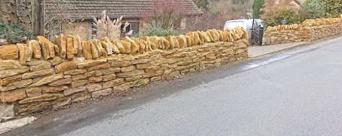 Limestone wall with lime mortar in North Nibley Gloucestershire