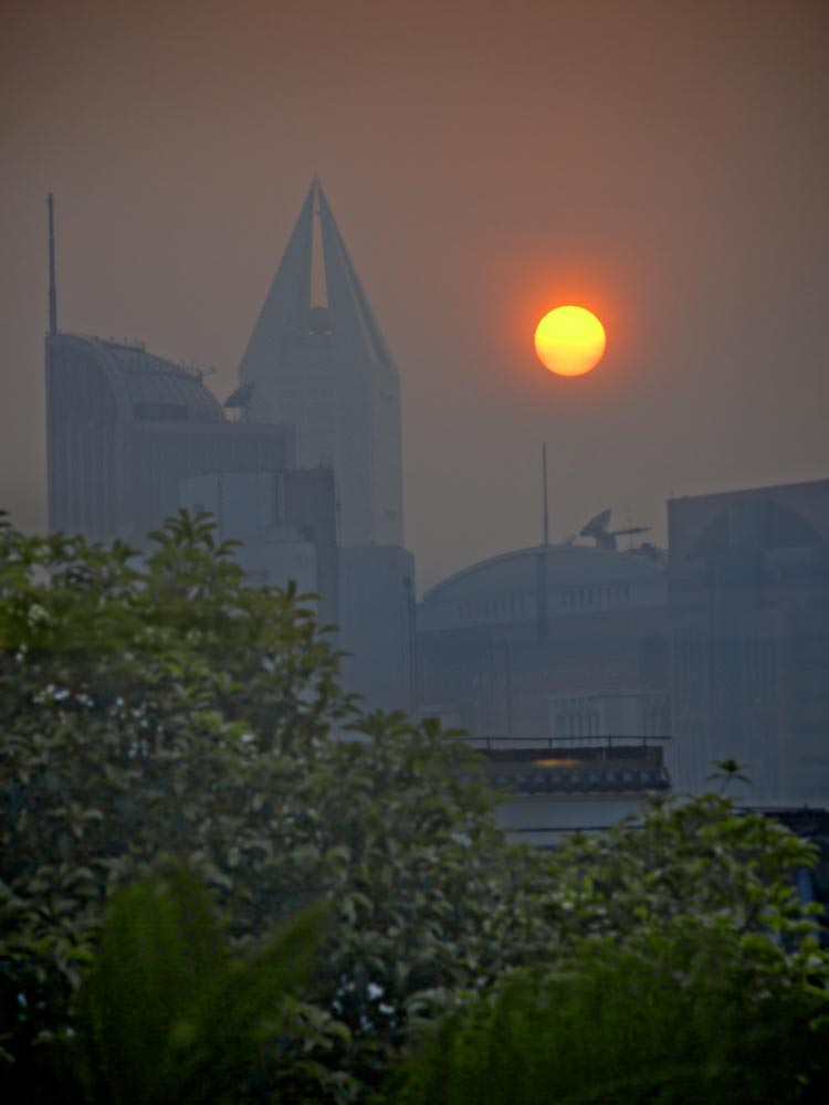 Photo: Shanghai Sunset The view from a second or third story restaurant window into the sunset over Shanghai. April 2009  #SunsetSaturday +TJ Kelly #Travel #China #Shanghai #Sunset