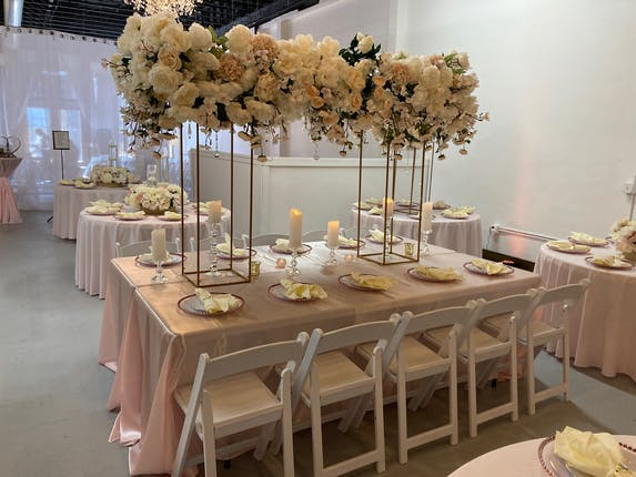 tables with flowers and folding chairs