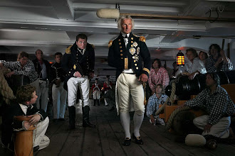 Photo: As the Battle of Trafalgar approaches, Nelson  (followed by Hardy) , does his tour of the ship and passes by gunners below deck