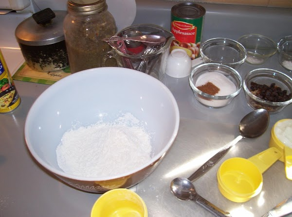in a large mixing bowel,beat together pumpkin,sugar,oil, and yogurt
