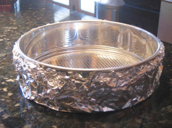 "Wrap outside bottom & sides of a 10"" springform pan with foil.  Spray..."