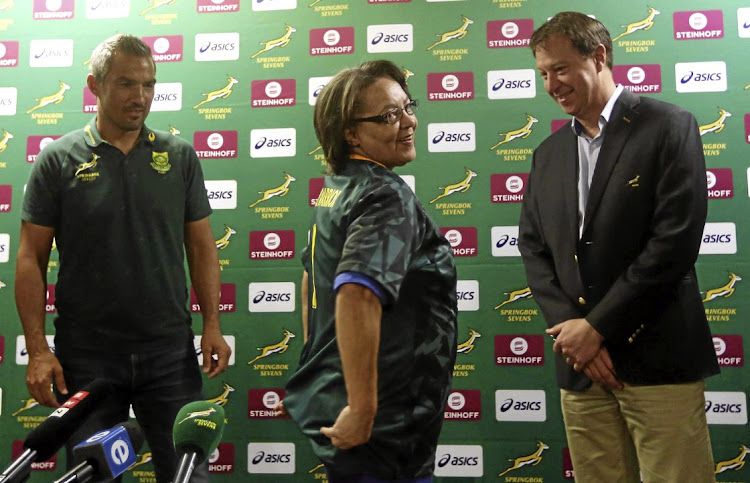 Cape Town mayor Patricia de Lille receives a 'water warrior' jersey from SA Rugby CEO Jurie Roux, right, and Blitzboks coach Neil Powell. The City has measures in place to save water during the local leg of the World Sevens Series at Cape Town Stadium over the weekend from December 9-10.