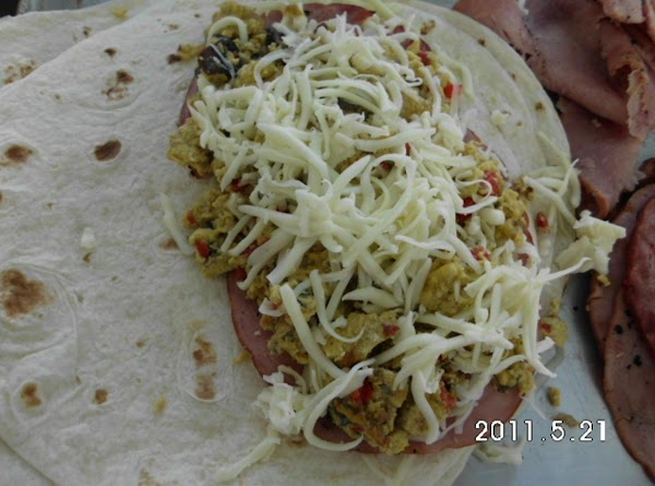Heat ham.  Slightly warm tortillas.  Assemble quesadilla's by placing a layer of...