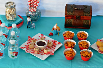 Photo: We made peanut butter sushi with jelly dipping sauce, served goldfish in cupcake liners, put out some madelines (perfect shell shape), and as I mentioned before I also made jell-o aquariums. I also grabbed our big popcorn bucket and filled it with pirates booty. We kept the juice inside.