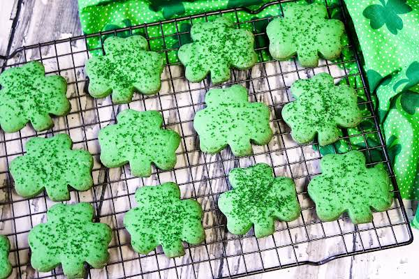 Shamrock Cookies On A Wire Rack.
