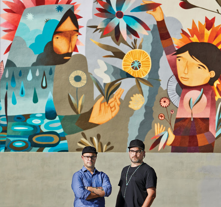 Pedro Barrios and Jaime Molina in front of their mural at 1515 Market Street. Photo: Jeff Nelson