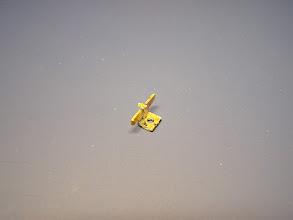 """Photo: 4. Příčník s konzolí pro uchycení ojničky předního podvozku. Skládá se ze tří částí - samotného příčníku, konzole ohnuté do """"L"""", obdélníčku zesilujícího závit a díl s očky pro strunu přítlaku podvozku."""