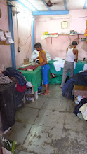 Photo: Here clothes are being ironed