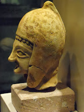 Photo: Terracotta head of a man, Archaic .......... Terracotta hoofd van een man, Archaisch