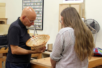 Photo: Gallery Photographer Mike Colella and 'trucker' Rebecca Meyerson pause to appreciate the pattern in the center of this impressive open-segmented bowl by Bob Grudberg.