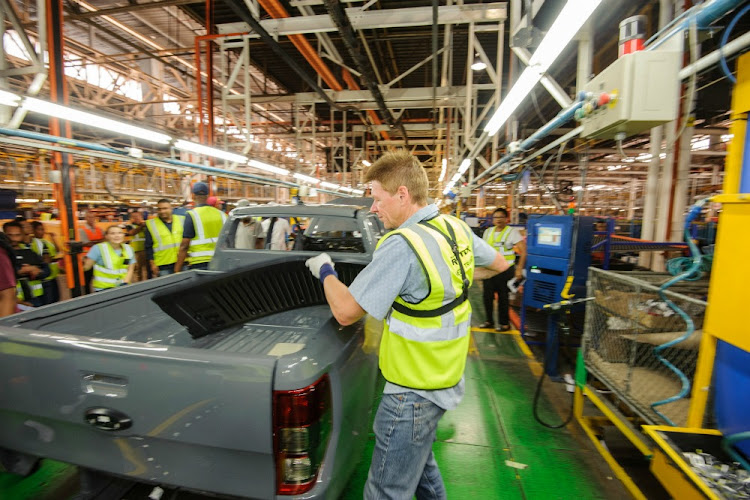 An automotive worker assembles a Ford Silverton bakkie at a vehicle manufacturing plant. Picture: SUPPLIED