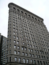 """Photo: West side of the Flatiron Building. """"The Flatiron Building was designed by Chicago's Daniel Burnham as a vertical Renaissance palazzo with Beaux-Arts styling.... The building sits on a triangular island block formed by Fifth Avenue, Broadway and East 22nd Street, with 23rd Street grazing the triangle's northern (uptown) peak. It anchors the south (downtown) end of Madison Square, and the north (uptown) end of the Ladies' Mile Historic District.""""http://www.preserve2.org/ladiesmile/"""