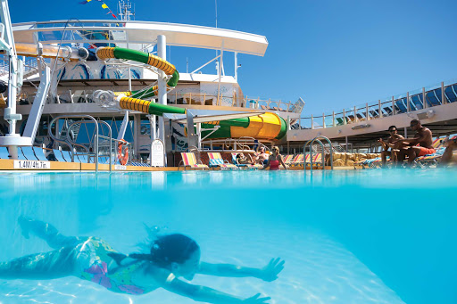 A girl swims underwater in one of the pools on Harmony of the Seas.